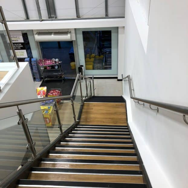 Bespoke glass staircase manufactured for Poundland store in Peterborough