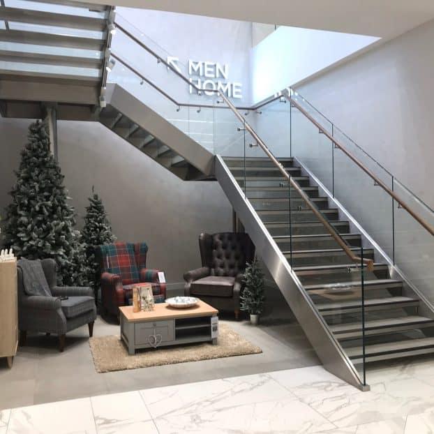 Glass staircases for retail giant Next Plc