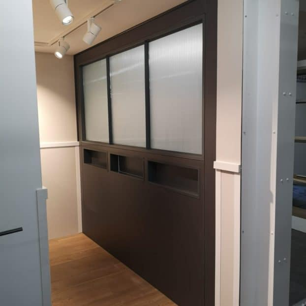 Aluminium glazed screens supplied to Next Plc shopping pods